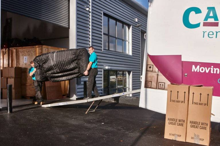 Moving a sofa onto a truck