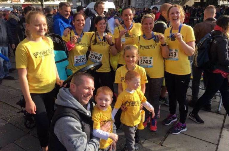 charity runners with medals